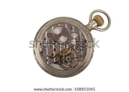 The mechanism of an old pocket watch isolated on a white background - stock photo