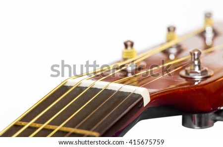 The mechanism of setting wood acoustic guitar close up - stock photo