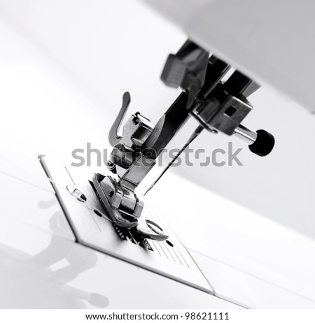 The mechanism of the sewing machine. - stock photo