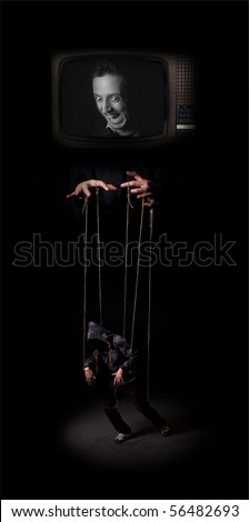 The media controls the marionette puppet - stock photo