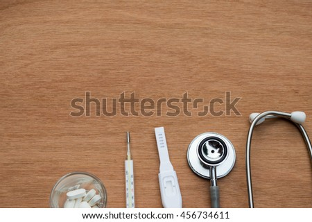 The medical healthy,medicine,notepad in wood background.Top view.