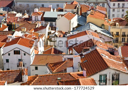 The medieval Alfama District orange rooftops seen from the Santa Luzia Belvedere. Lisbon, Portugal. - stock photo