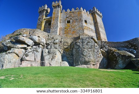 The medieval castle at Penedono, northern Portugal, with pyramidal crenellations and prism towers. Built on huge granite boulders - stock photo