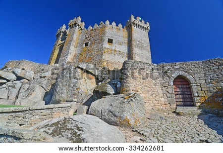 The medieval castle of Penedono in northern Portugal, with prism turrets and cobblestones leading to entrance gateway - stock photo