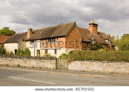The medieval farmhouse in Wilmcote near Stratford Upon Avon which was home to the mother and grandparents of the playwright William Shakespeare. - stock photo