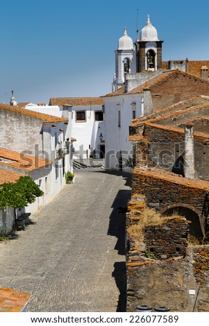 The Medieval Fortress of Monsaraz with the typical white narrow streets  - stock photo
