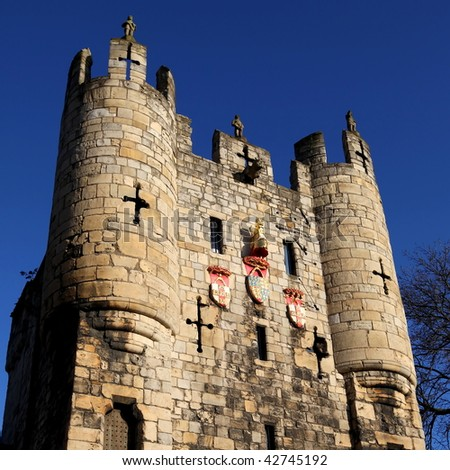 The medieval stone tower of Monkgate Bar on the city walls in York England - stock photo