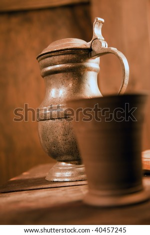 the medieval tin jug on table