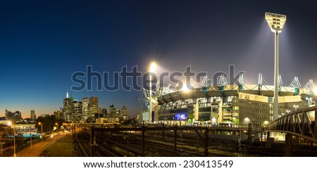 The Melbourne skyline  and the Melbourne Cricket Ground at sunset - stock photo
