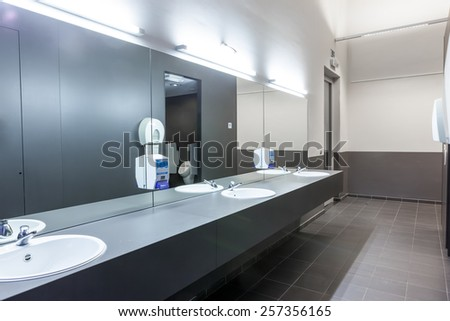 the men's room with several sinks