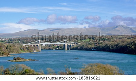 The Menai Suspension Bridge between Anglesey and the mainland of Wales.  This was the first modern suspension bridge in the world.  - stock photo