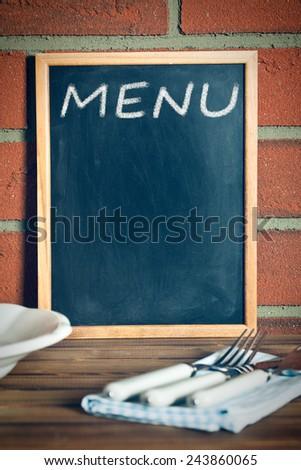 the menu blackboard before brick wall - stock photo