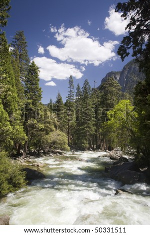 The Merced River flowing through Yosemite National Park - stock photo