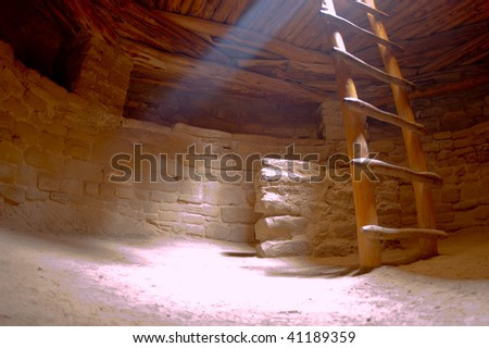 The Mesa Verde Spruce Tree Kiva is a small underground dwelling and is part of a Native American cliff dwelling archaeological site near Durango, Colorado - stock photo