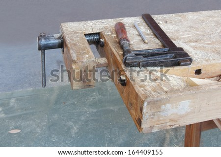 The metal clamp on a wooden carpenter's clamps