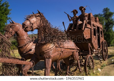 The metal horse and wagon in the California. - stock photo