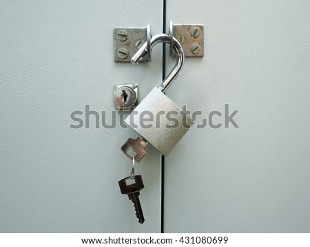 The metal lock with key on a door. - stock photo