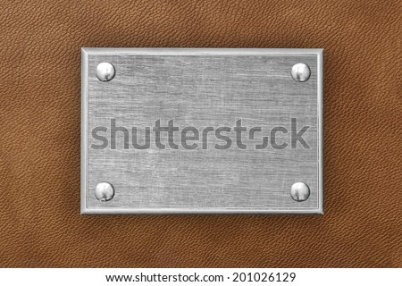 The metal plate on the background of the skin  - stock photo