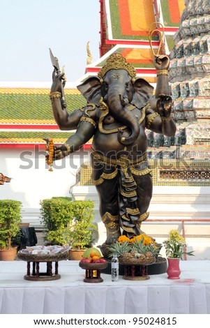 The metallic sculpture of Ganesha is standding - stock photo