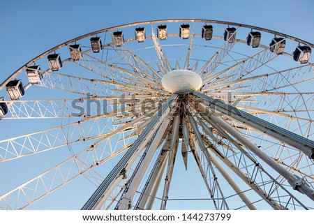 The 60 meter ferris wheel on top of the Transit Centre in Surfers Paradise, Gold Coast, Queensland Australia. - stock photo