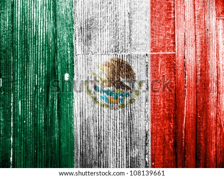 The Mexican flag painted on wooden pad - stock photo