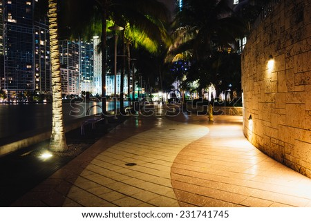 The Miami River Waterfront at night, in downtown Miami, Florida. - stock photo