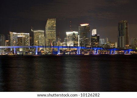 The Miami skyline at night with beautifully lit bridge; copy space.