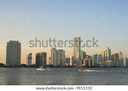 The Miami skyline during late afternoon and a couple of pleasure boats. - stock photo