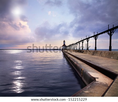 The Michigan City East Pierhead Lighthouse At Sunset On Lake Michigan, Michigan City, Indiana, USA - stock photo