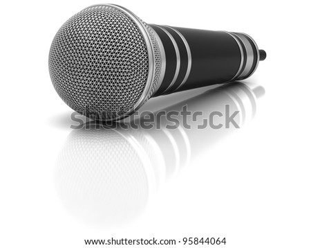 The microphone on a white glossy surface. - stock photo