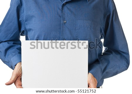The mid section of a man in a blue dress shirt, holding a blank white sign, isolated on white. - stock photo
