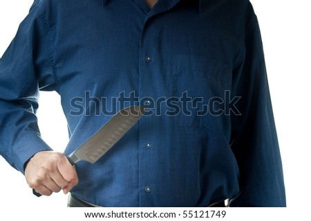 The mid-section of a man in a blue dress shirt, holding a large knife, isolated on white.