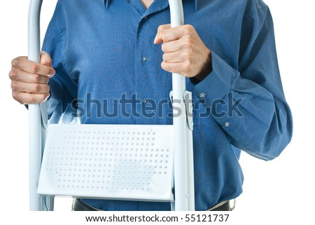 The mid-section of a man in a blue dress shirt, holding a white step ladder, isolated on white. - stock photo