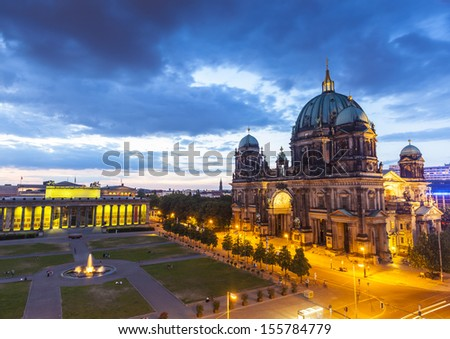 The mighty Berlin cathedral and Altes Museum (1823) illuminated at night in central Berlin, Germany. Stitched panoramic image, detailed when viewed large.