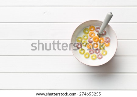 the milk with fruity cereal rings  - stock photo