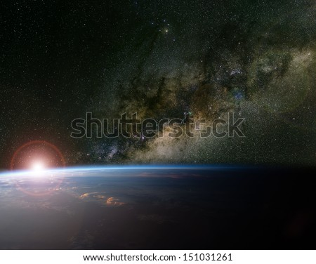 The Milky Way and sunrise over planet Earth. Elements of this image furnished by NASA. - stock photo