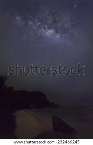 The milky way in the night sky with a tropical beach in the foreground. Taken at Anse Source D'Argent in the Seychelles. - stock photo