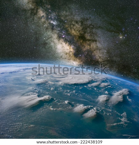 The Milky Way over Borneo with large thunderstorms. Elements of this image furnished by NASA.  - stock photo