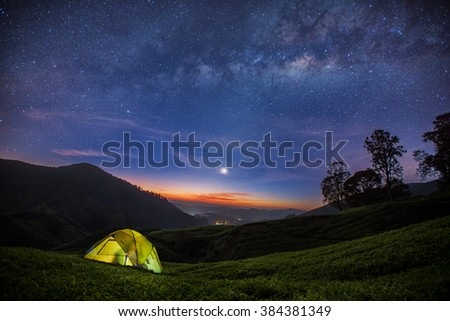 The Milky Way rises over the Tea plantation in Cameron highlands, Malaysia - stock photo