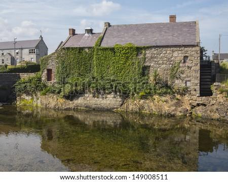 The mill in Annalong Ireland on a sunny morning - stock photo