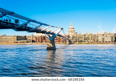 The Millennium Bridge and St Paul Cahedral in London - stock photo