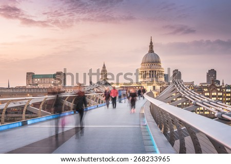 The Millennium Bridge to the St Paul's Cathedral in Twilight with Moving People - stock photo