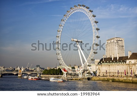 The Millennium Wheel across the river thames in London - stock photo
