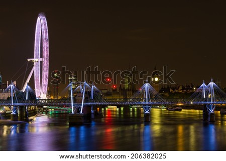 The Millennium Wheel and Houses of Parliament, night shot with a long exposure - stock photo