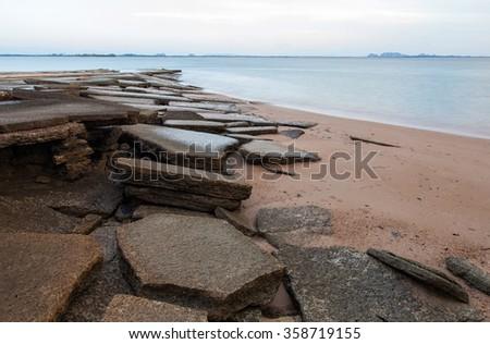 The 75 million years old shell graveyard Krabi , Fossil Shell Beach Krabi , Thailand. - stock photo