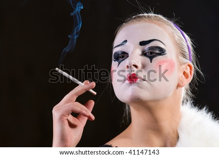 The mime with a cigarette on black background
