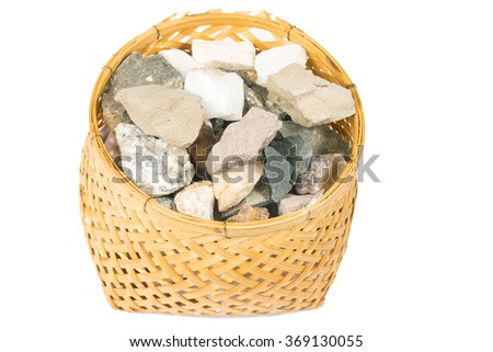 the Mineral  marlstone in bamboo basket handmade isolated on white background - stock photo