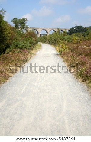 The mineral tramways cost to coast trail with Carnon stone viaduct in the distance. - stock photo
