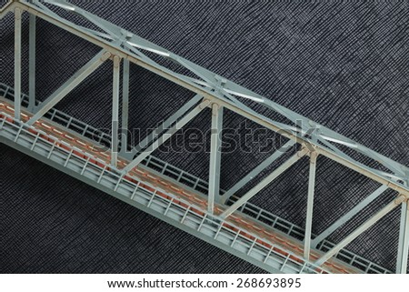 The miniature plastic model of railway bridge represent the railway construction object concept related idea.