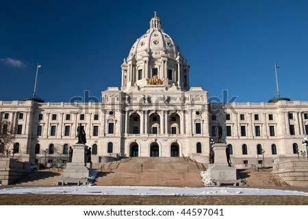 The Minnesota State Capitol is located in Minnesota's capital city, Saint Paul, and houses the Senate, House of Representatives, the Office of the Attorney General and the Office of the Governor. - stock photo